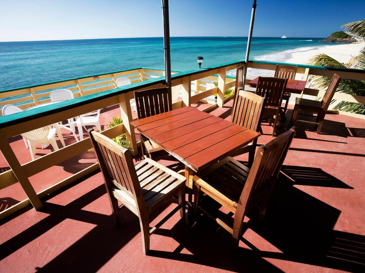 Try one of the beachfront eateries in Bolans