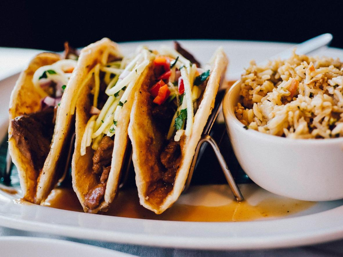 Korean beef tacos are loaded with fried veggies and spicy sauce