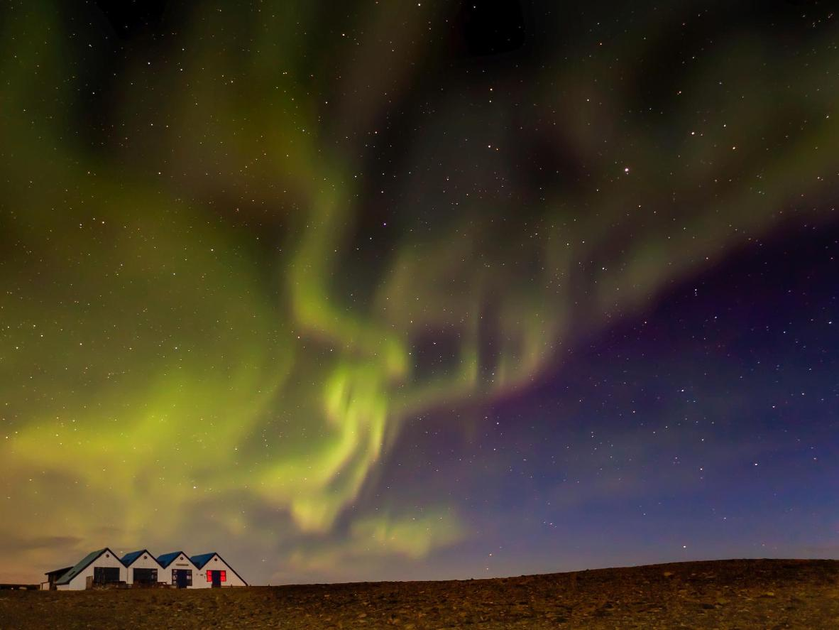 Watch the Aurora Borealis light up the sky from the tiny hamlet of Kálfafell