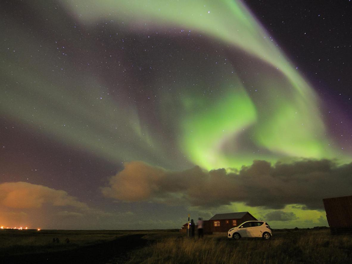 The Northern Lights above the fishing village of Sandgerdi, Iceland
