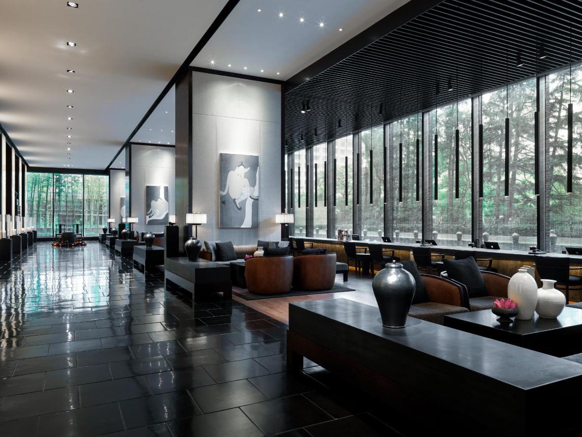 Intimate lighting and dark wood minimalism at The Puli Hotel & Spa