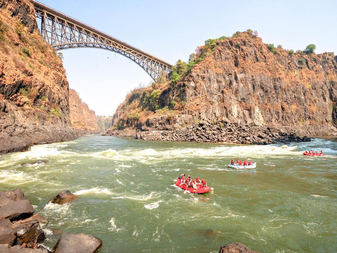 Bungee jump off the bridge spanning between Zambia and Zimbabwe or white water raft below