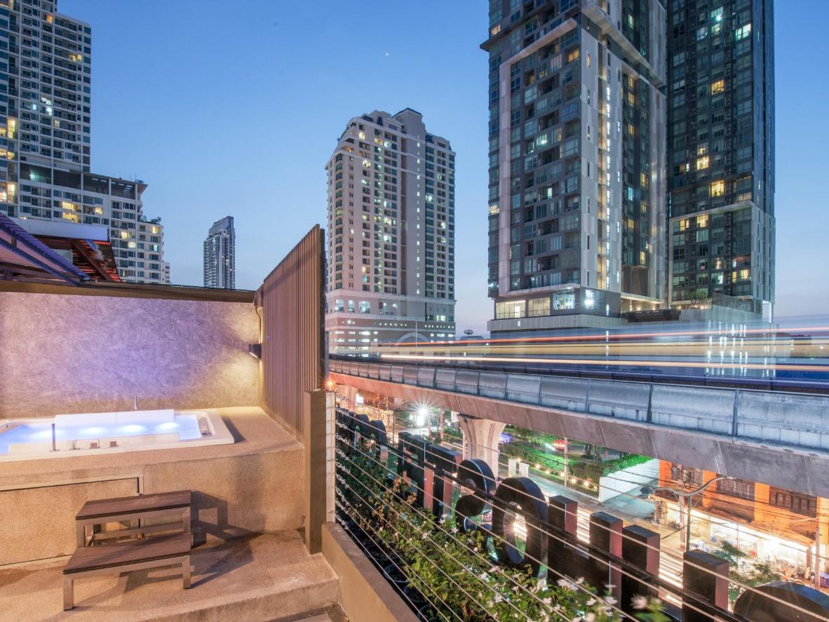 Head upstairs to the roof terrace to soak in the hot tub at The Posh Phayathai