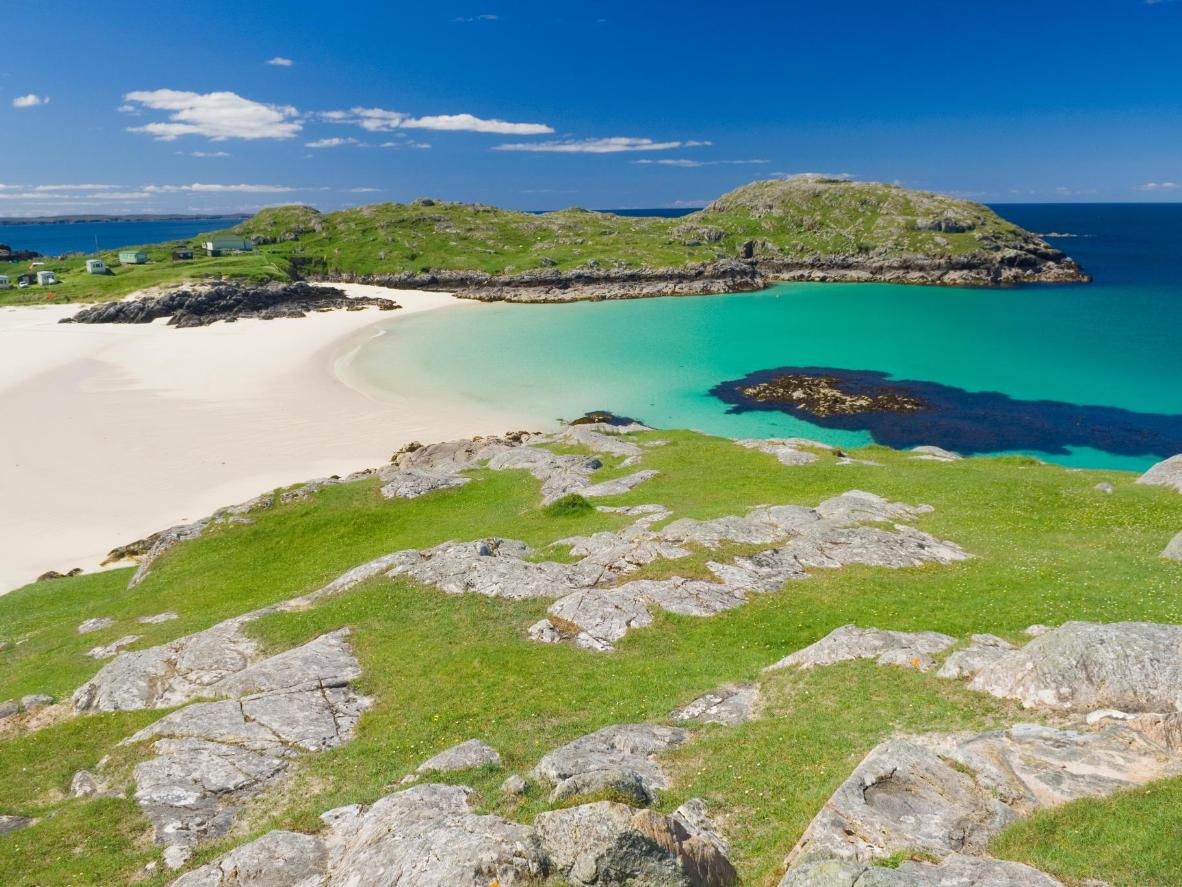 Discover bright white sand, blue seas, and playful porpoises in the Scottish Highlands