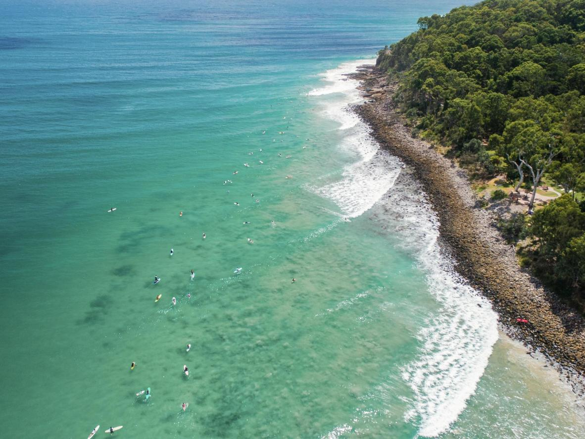 Visit the famous surfing hotspot of Noosa as you drive up Australia's East Coast