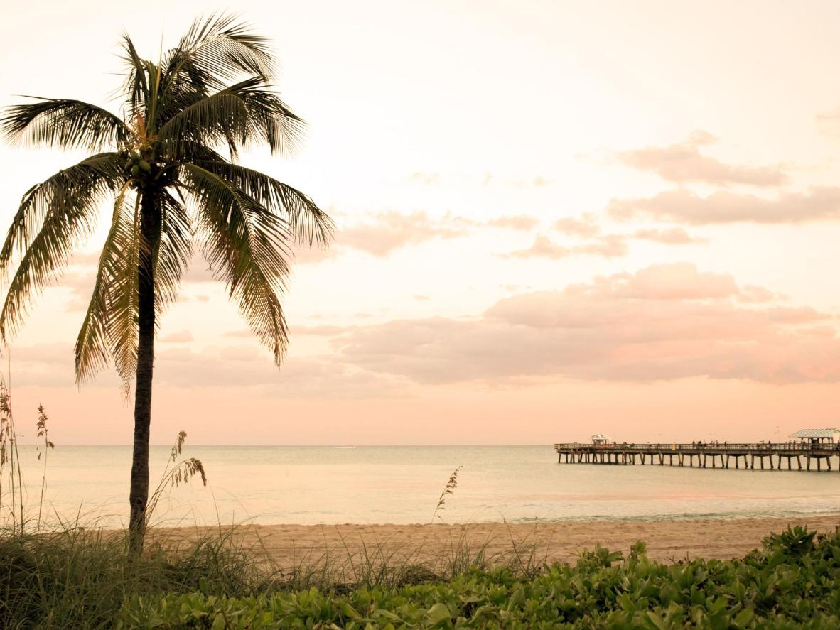 Watch the sun go down over gleaming white sand in Lauderdale-by-the-Sea