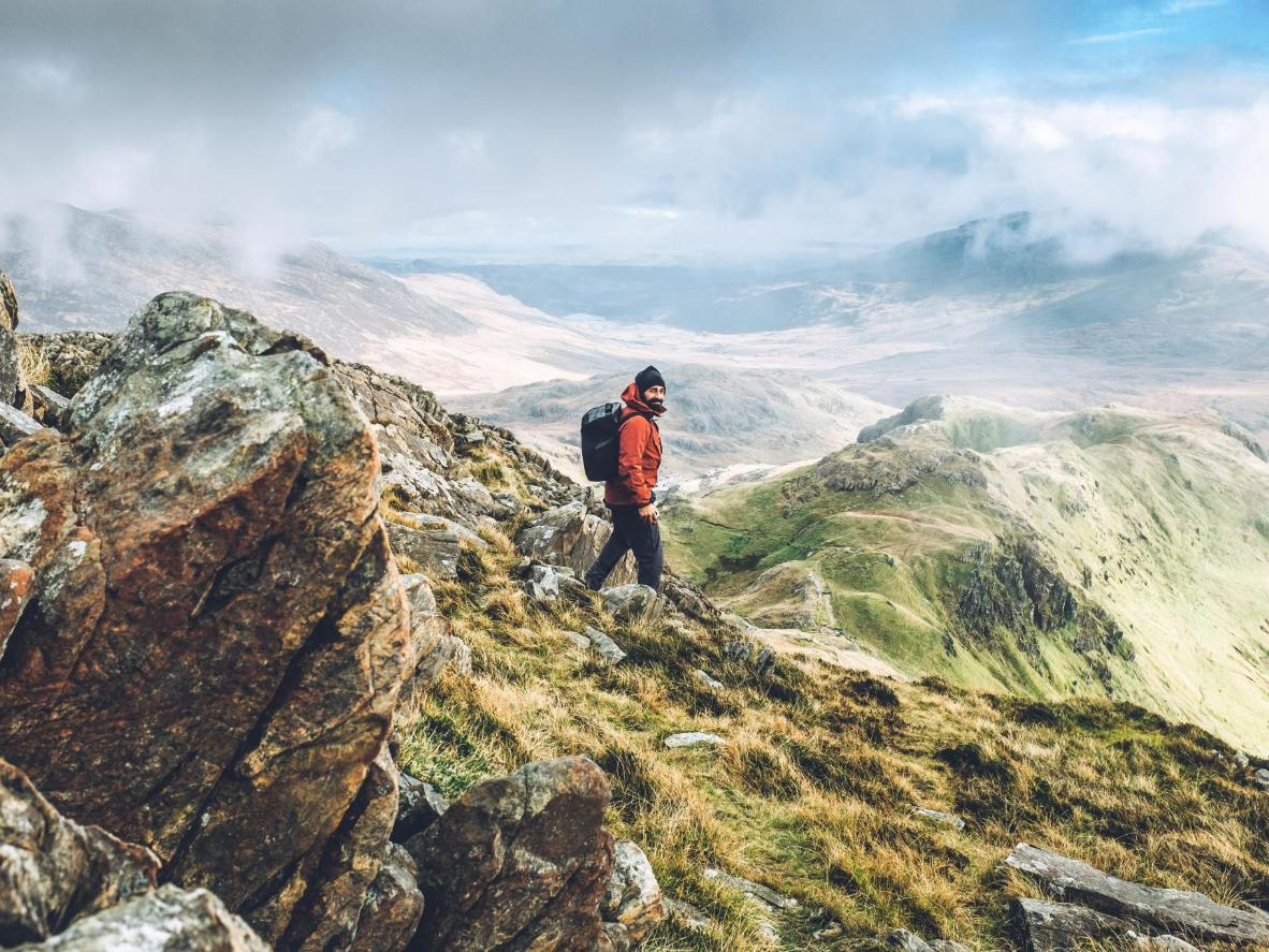 Follow the Llanberis Path up to the summit of Snowdon, passing glacial corries and knife-edged ridges