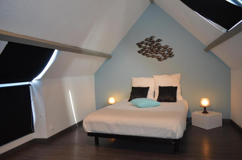 A bed or beds in a room at Coetquen