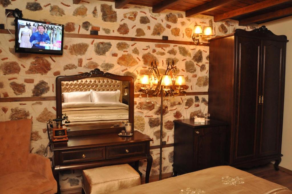 Televizorius ir (arba) pramogų centras apgyvendinimo įstaigoje Centauera Hotel - Adult Only