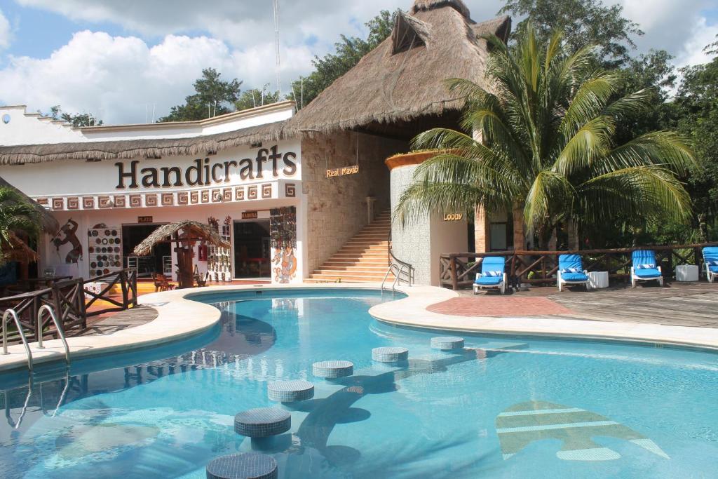 The swimming pool at or near Hotel & Bungalows REAL MAYAB