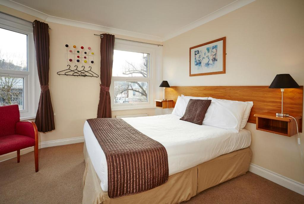 A bed or beds in a room at The Terrace Lodge Hotel