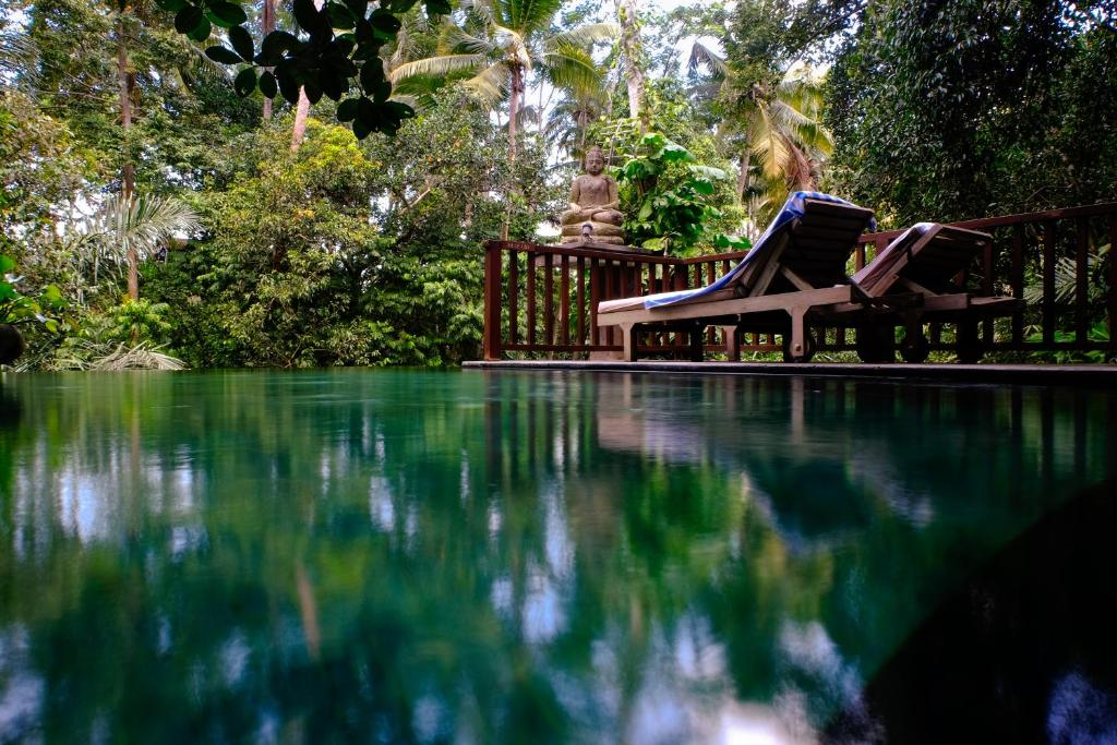 The swimming pool at or close to Harum Sari Ubud Private Villa
