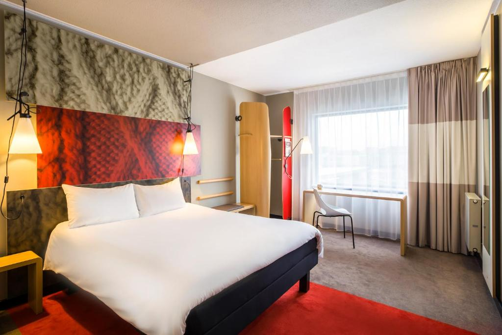 A bed or beds in a room at ibis London Gatwick Airport