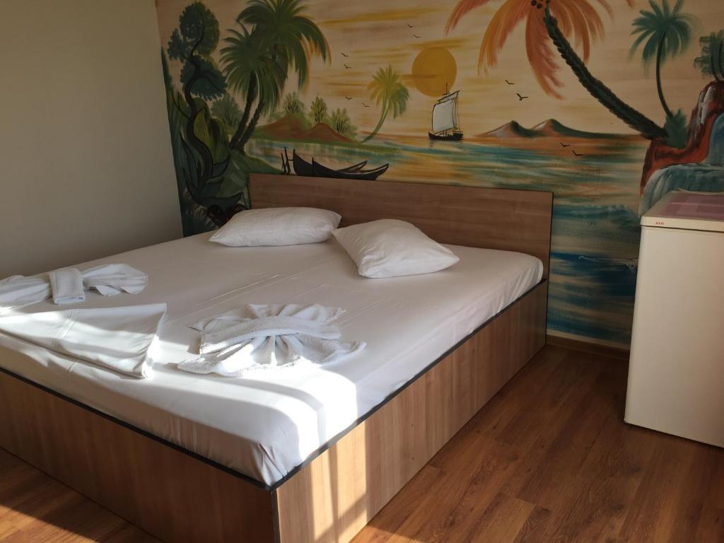 Un pat sau paturi într-o cameră la Vila Nusa