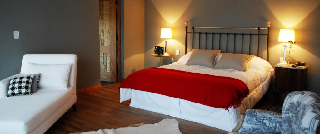 A bed or beds in a room at Kkala Boutique Hotel