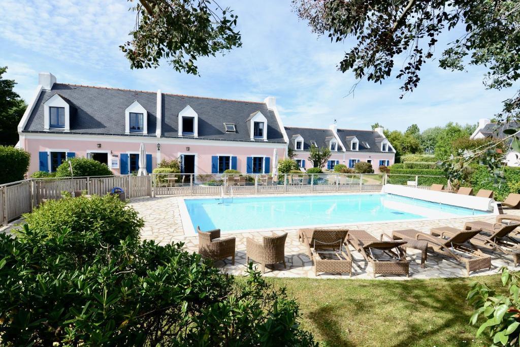 The swimming pool at or near La Désirade - Hôtel, Spa & Restaurant