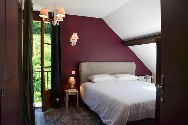 A bed or beds in a room at D'Tour Gourmand