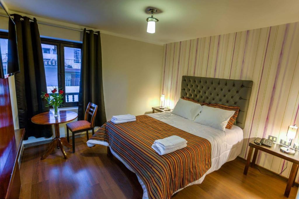Cama o camas de una habitación en Ureta Hotel
