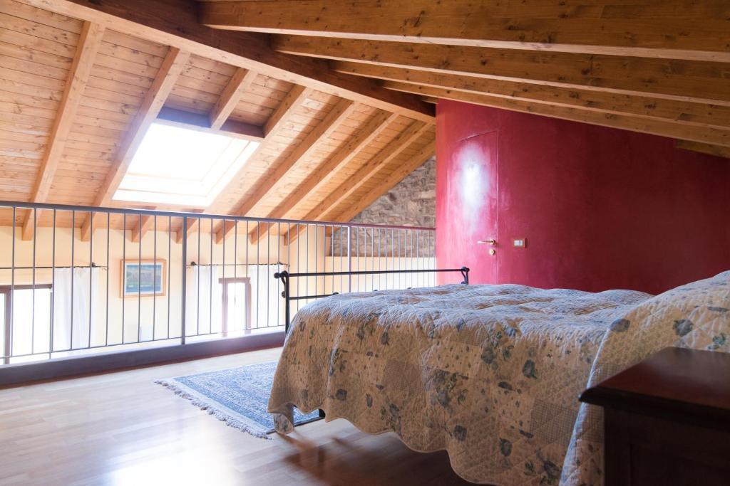 Un ou plusieurs lits dans un hébergement de l'établissement Belvedere Apartments on Como Lake