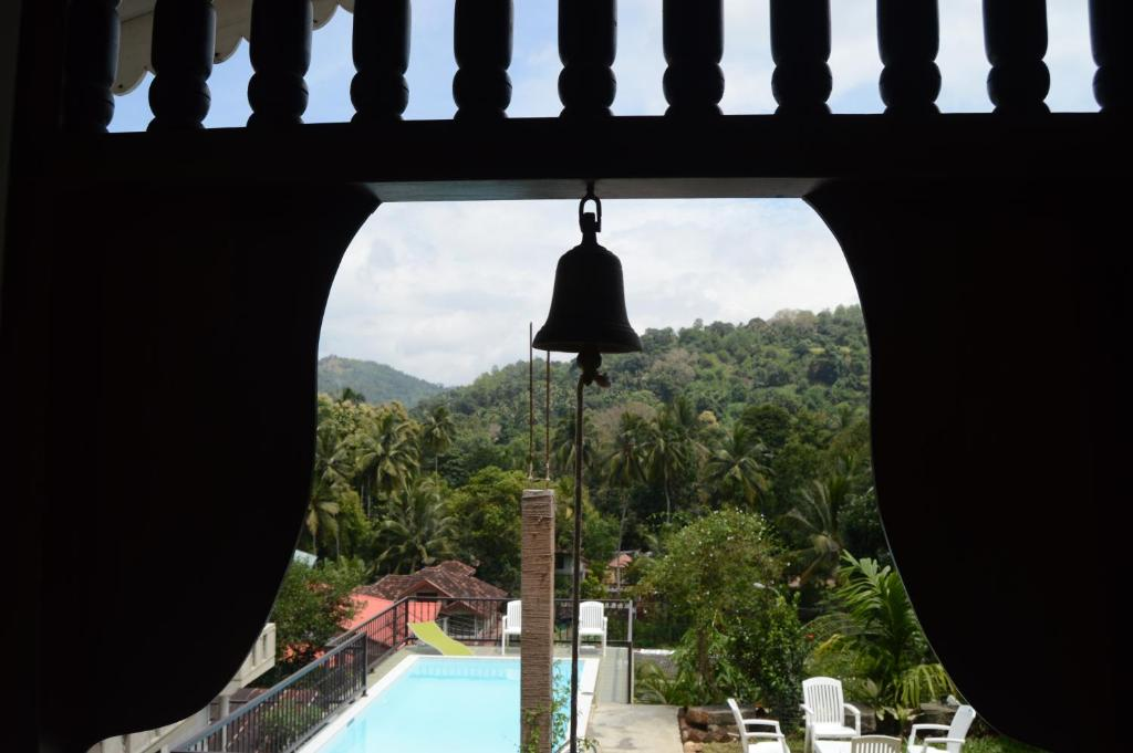 A view of the pool at Muduna Walawwa Resort or nearby