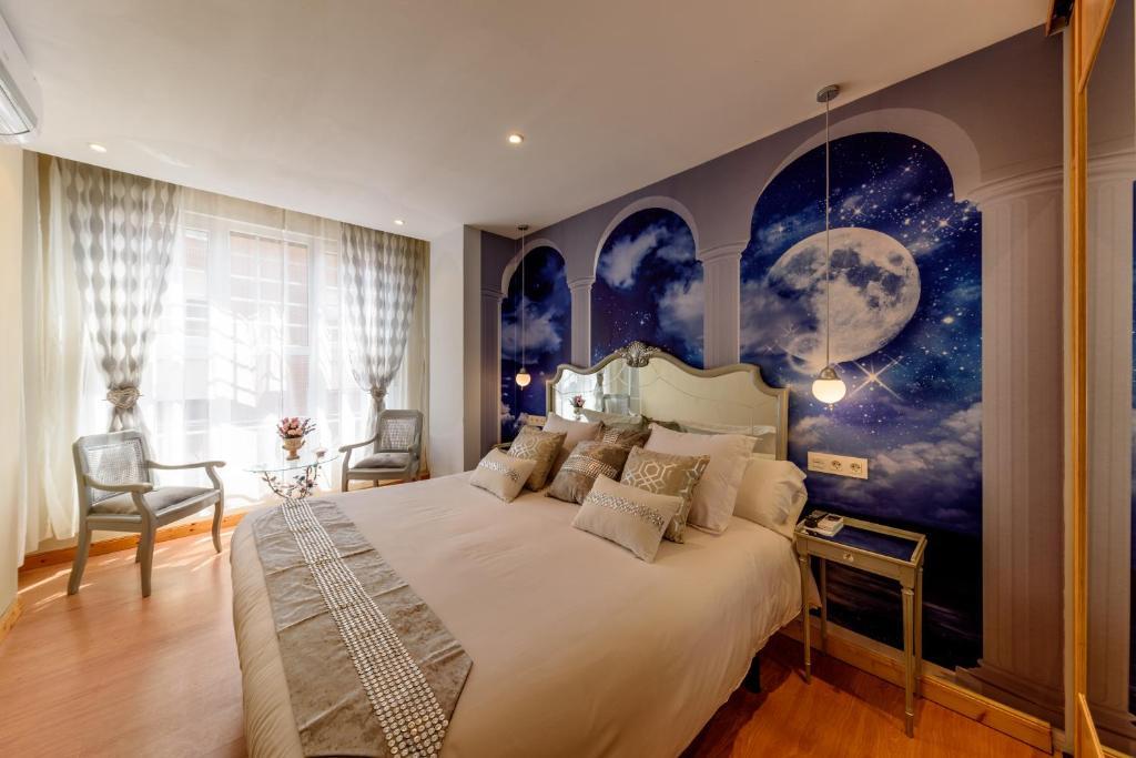 A bed or beds in a room at Hosteria Villa de Castro