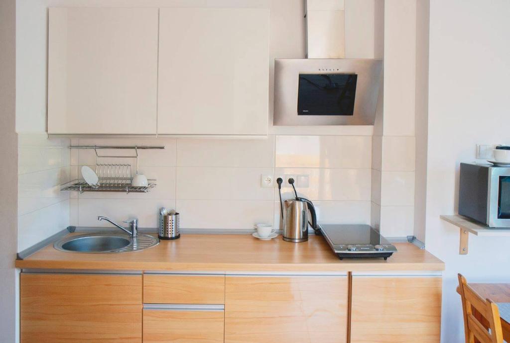 Kuchnia lub aneks kuchenny w obiekcie Apartament Sunny