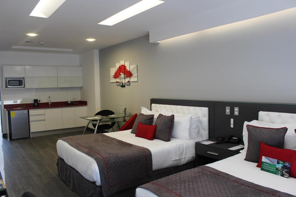 A bed or beds in a room at Citimed Hotel