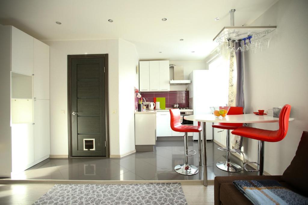 Кухня или мини-кухня в Apartment Star