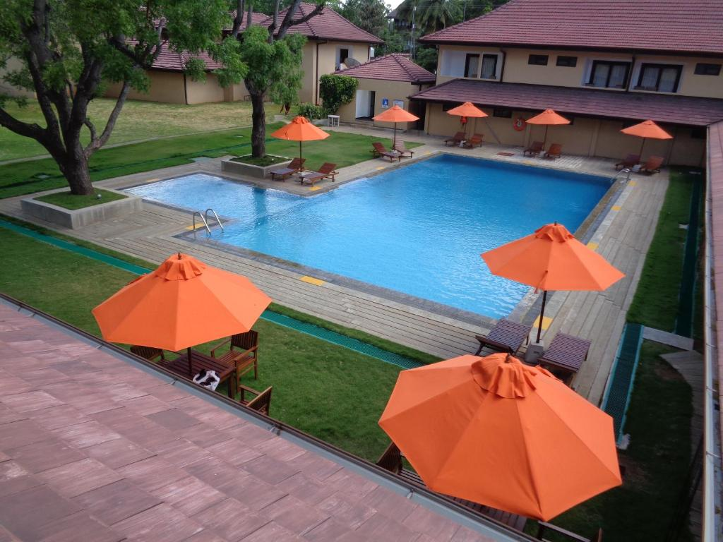 A view of the pool at Rajarata Hotel or nearby