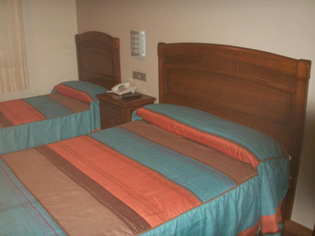 Un ou plusieurs lits dans un hébergement de l'établissement Hostal La Nava