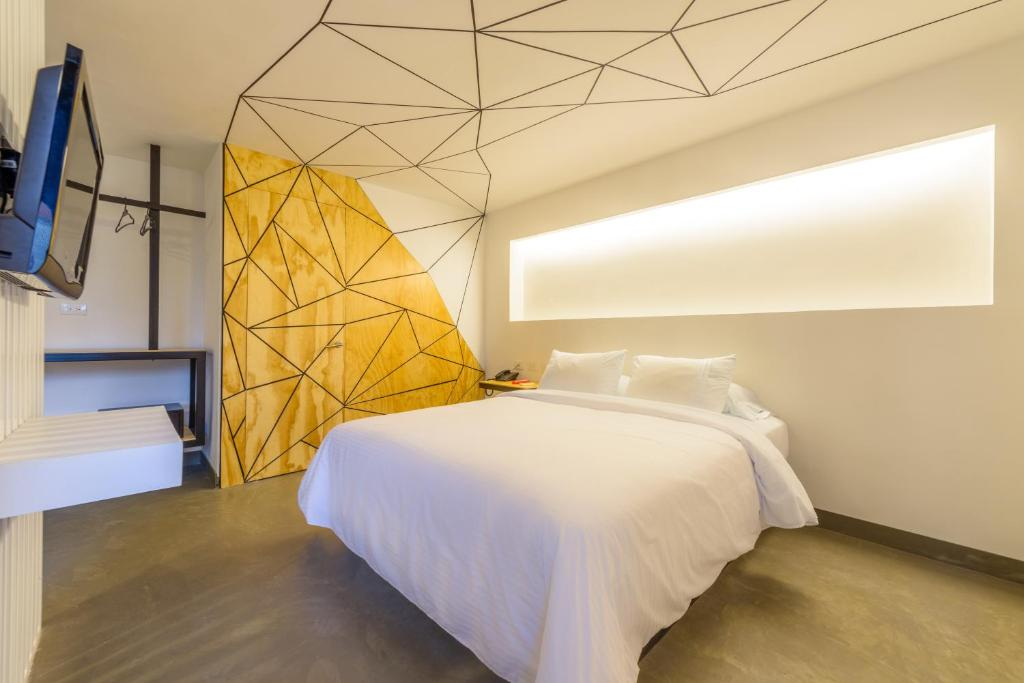 A bed or beds in a room at Hotel El Peñon