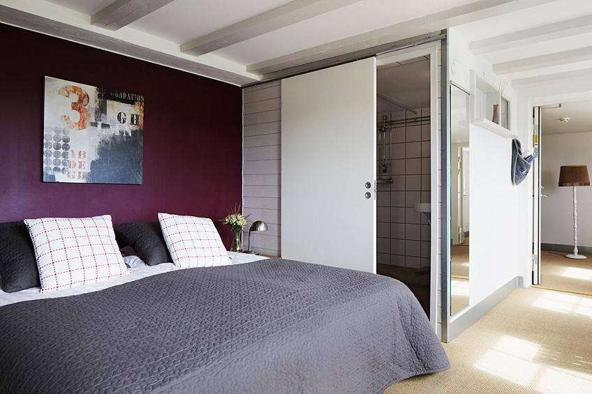 A bed or beds in a room at Hotel Magazin1