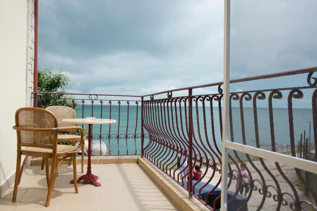 Ein Balkon oder eine Terrasse in der Unterkunft Vila Rasarit de Soare