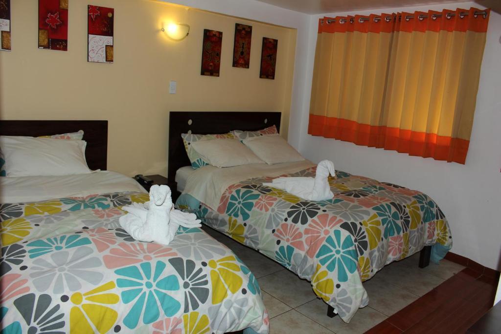 Cama o camas de una habitación en Hospedaje Qori Punku
