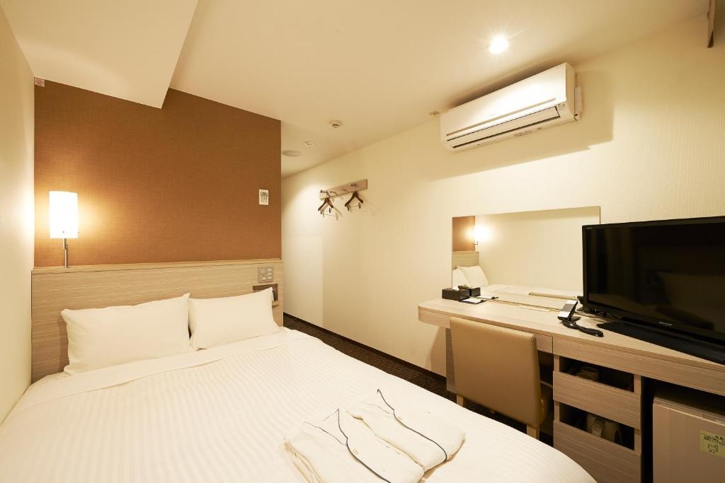 Cama o camas de una habitación en Sotetsu Fresa Inn Tokyo Tamachi