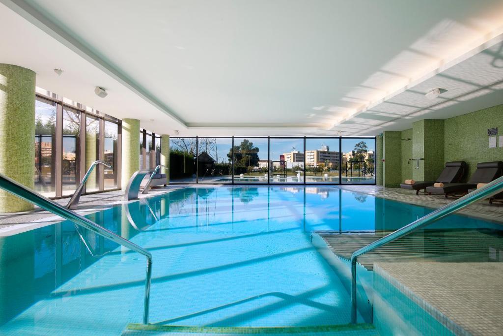 The swimming pool at or near Melia Braga Hotel & Spa