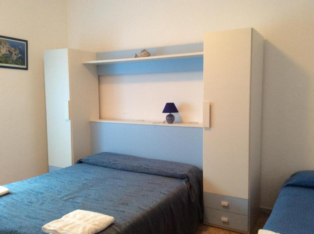 A bed or beds in a room at Raggi di Sole