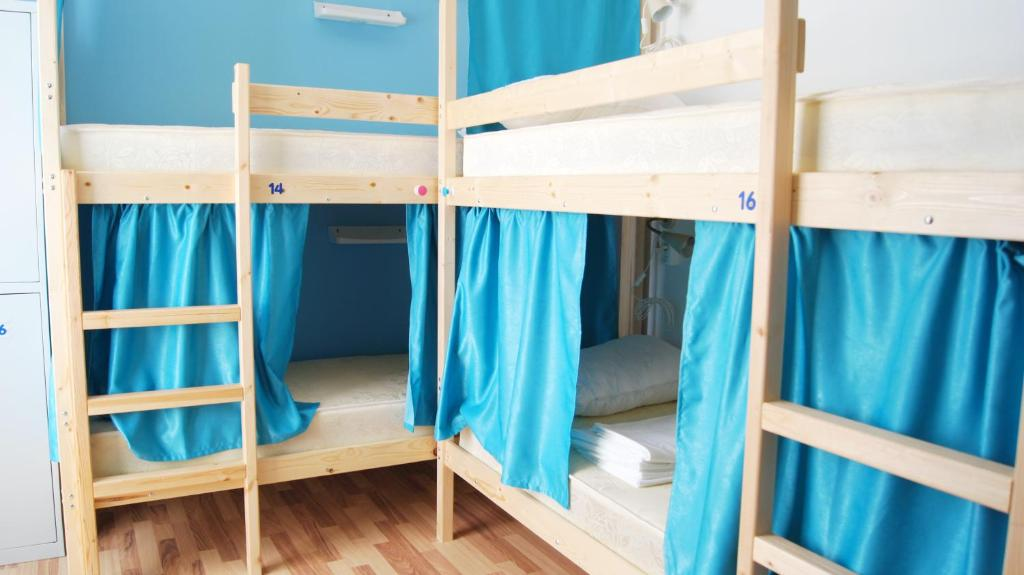 A bunk bed or bunk beds in a room at Hostel Yakor
