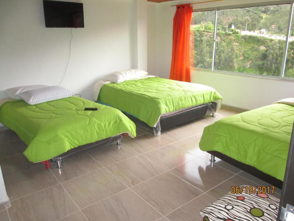 A bed or beds in a room at Los Recuerdos de Florito y Leo