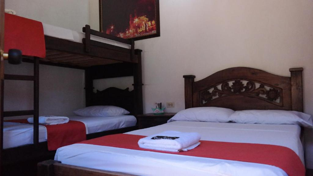 Cama o camas de una habitación en Hotel Casa Posada Don Chepe
