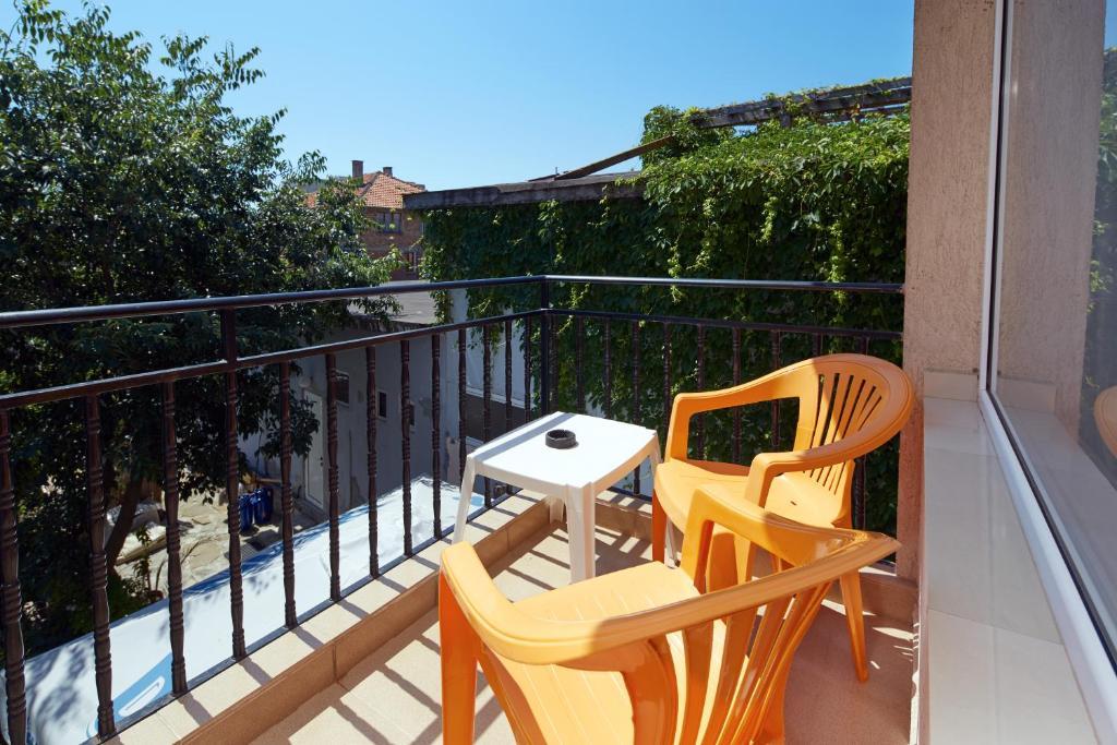 Een balkon of terras bij Guest House Ekaterina