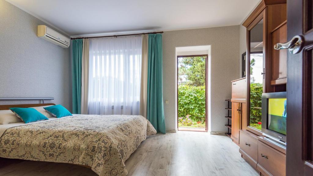 Кровать или кровати в номере Гостевой Дом Таврический