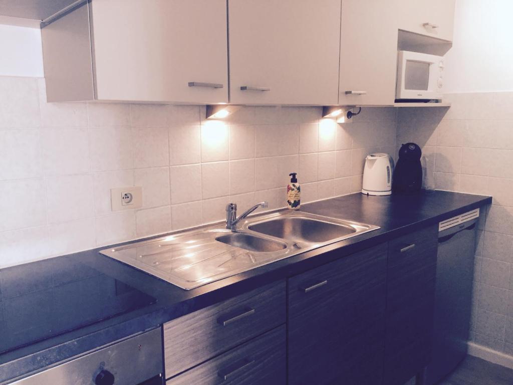 A kitchen or kitchenette at Studio Ostend Living