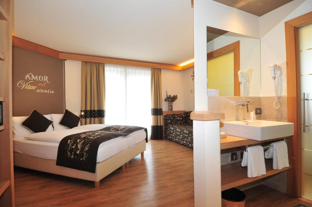 Postel nebo postele na pokoji v ubytování Hotel B&B Bondi