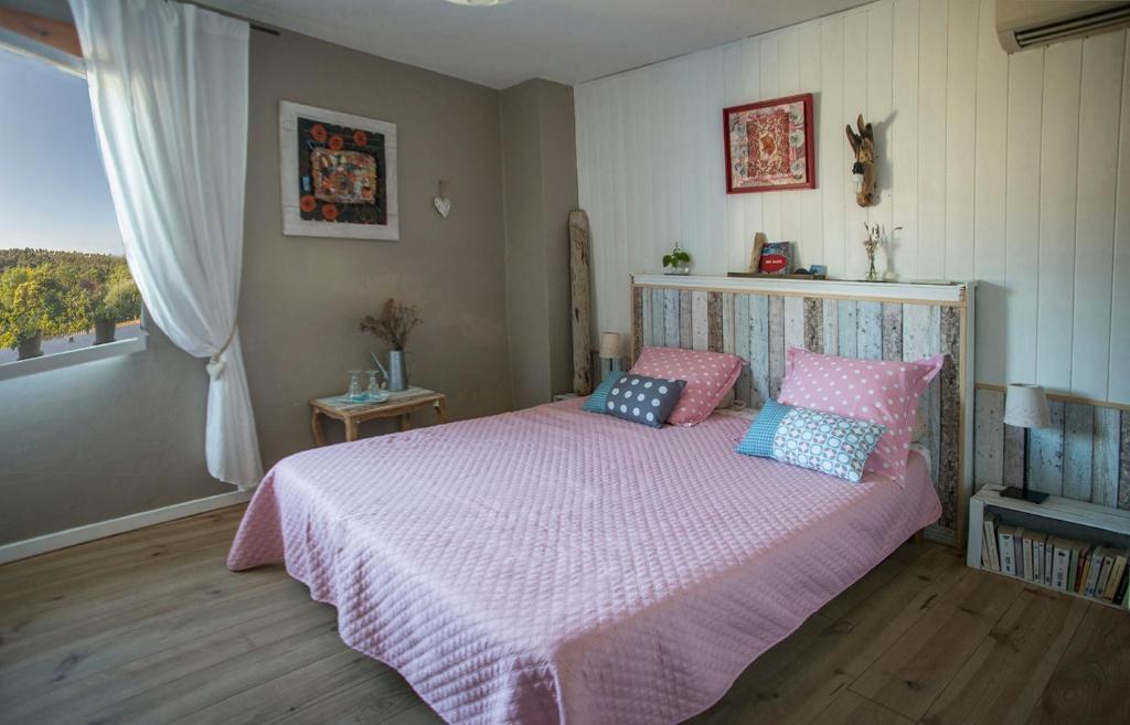 Un ou plusieurs lits dans un hébergement de l'établissement Chambre d'hôtes, Côté-Vignes