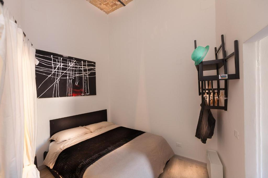 A bed or beds in a room at Paradiso a San Pietro