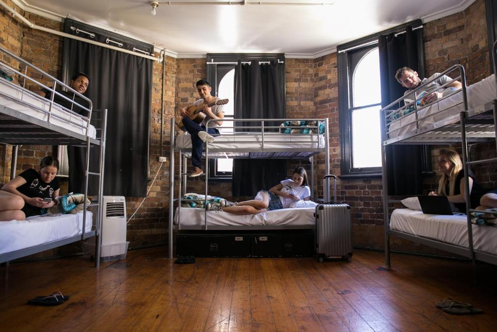 A bunk bed or bunk beds in a room at Nomads Brisbane Hostel