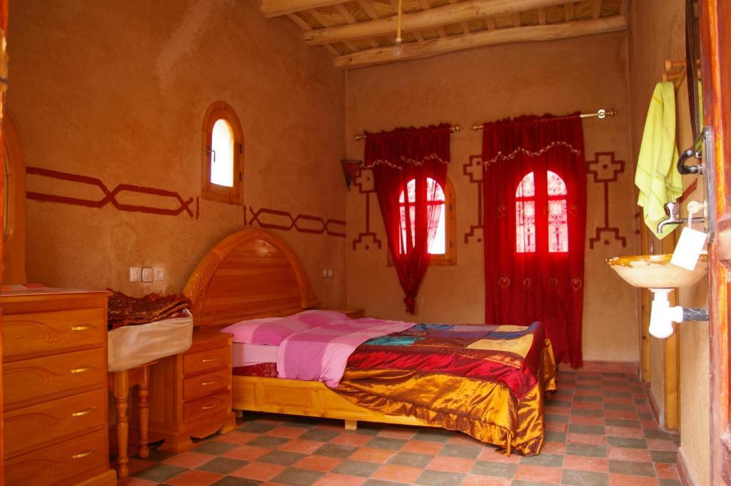 Ein Bett oder Betten in einem Zimmer der Unterkunft Auberge Des Jardins du Dades