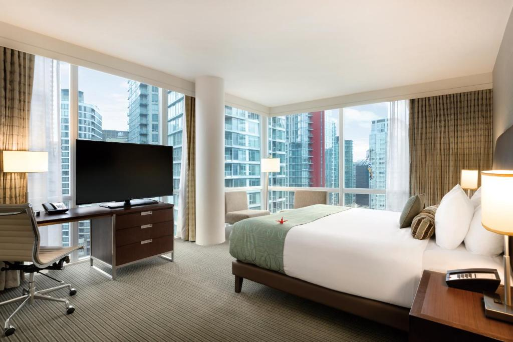 A television and/or entertainment centre at Coast Coal Harbour Vancouver Hotel by APA