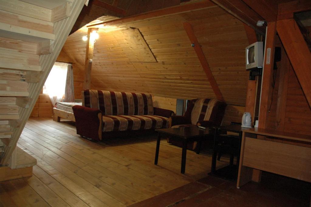 A seating area at Lesnaya Baza Shishki